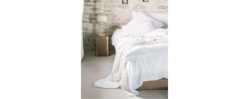 Comment habiller un lit avec un plaid?